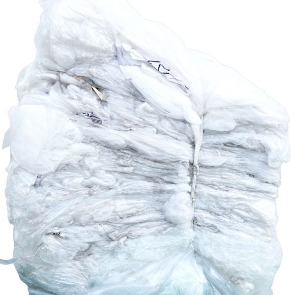 Bale of soft plastic, plastic wrap tied with one strap only